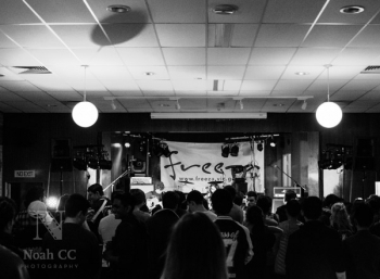 The stage and crowd at the Monash Music Battle. Photo by Noah CC Photography